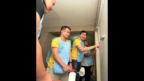 CapitaLand staff make over homes of the needy