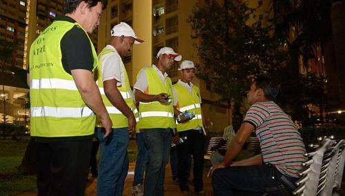 Migrant workers spend rest days volunteering