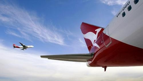 Loss-making Qantas announces big cuts