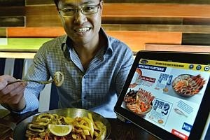 Ordering food via iPads speeds things up at Fish & Co