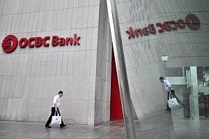 OCBC to disburse first WCS payouts