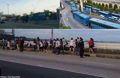 Workers walk across Causeway after buses refuse to pay new toll charges